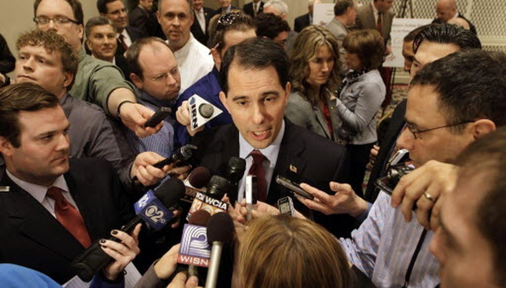 Gov. Scott Walker addresses the media after speaking to the Illinois Chamber of Commerce in Springfield, Ill.