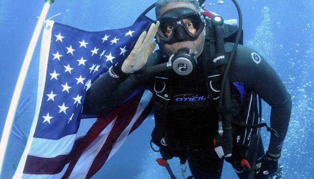 Allen West went scuba diving with a group of veterans, and the American flag, on June 12, 2011.