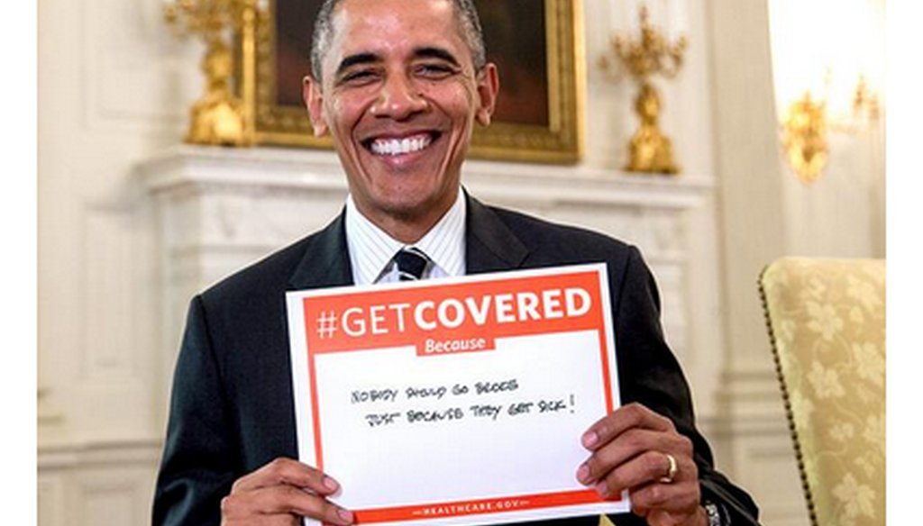 """The White House on Dec. 12, 2013, tweeted this picture of President Barack Obama holding a sign urging Americans to get health coverage """"because nobody should go broke just because they get sick."""""""