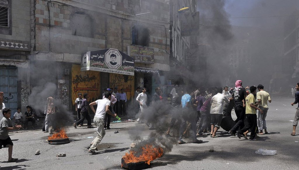 Anti-government protesters clash with Yemeni security forces in Taiz in 2011.