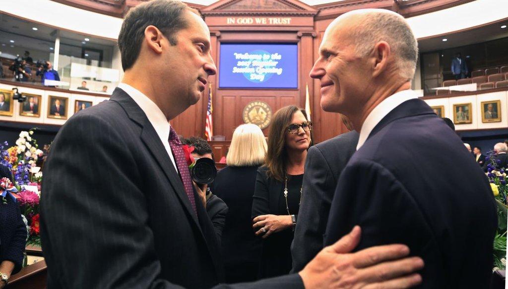 Florida Senate President Joe Negron, R- Stuart, greets Florida Governor Rick Scott on the floor of the Senate during the first day of the 2017 session. (Scott Keeler | Times)
