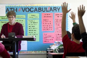 Students wave with answers in Elva Cantu's math class at Austin's Graham Elementary in November 2011 (Photo: Ralph Barrera, Austin American-Statesman).
