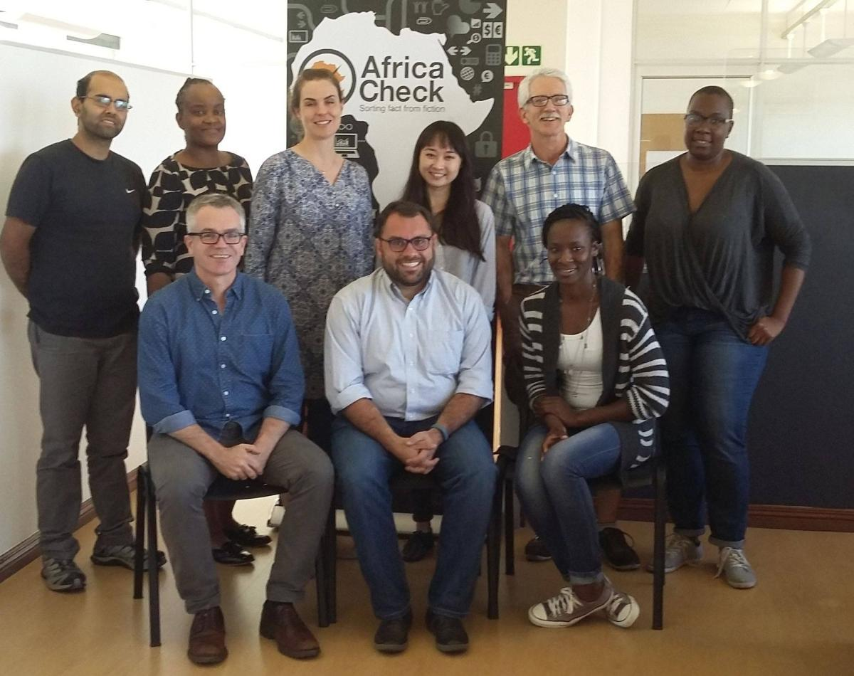 Some of the staff of Africa Check and PolitiFact in a meeting in Johannesburg, South Africa.