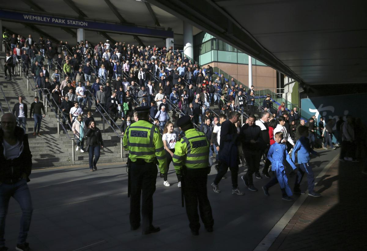 Police observe the crowds outside Wembley Park Station ahead of a soccer match, following a terrorist attack Friday on a train at Parsons Green Station, in London, on Sept. 16, 2017. (AP)
