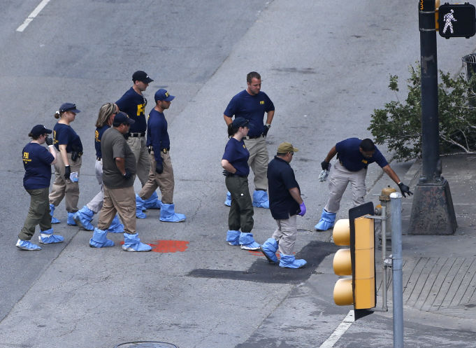 An FBI evidence response team works the crime scene, Sunday where five Dallas police officers were killed Thursday in Dallas. (AP)