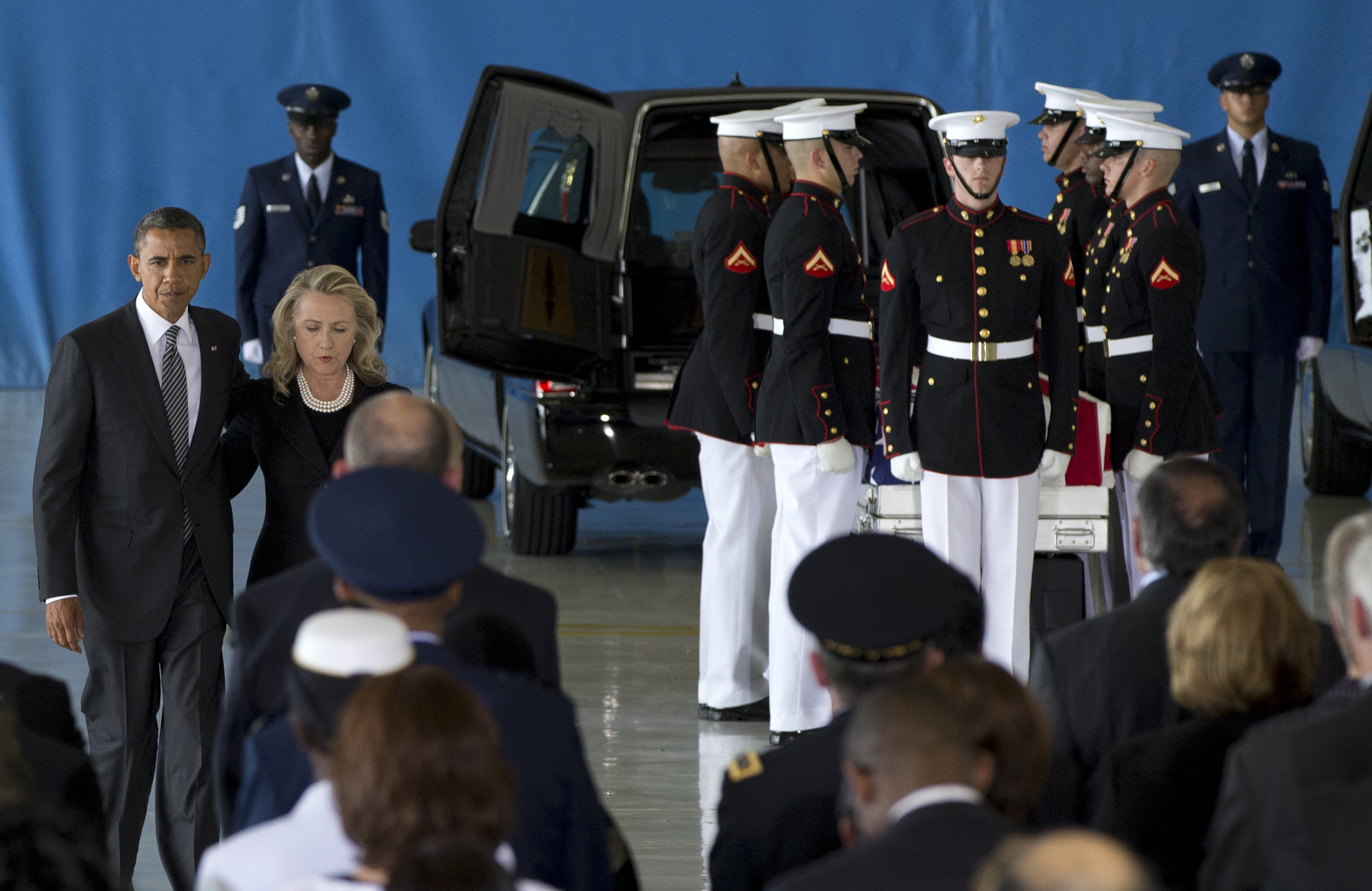 President Obama and then-Secretary of State Hillary Clinton walk back to their seats after speaking at a transfer of remains ceremony  for the Benghazi victims Sept. 14, 2012, at Joint Base Andrews. (AP Photo)