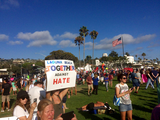 A larger counter-protest in Laguna Beach, Calif., faces off against a smaller group demonstrating against illegal immigration on Aug. 20, 2017. (AP/Christopher Weber)