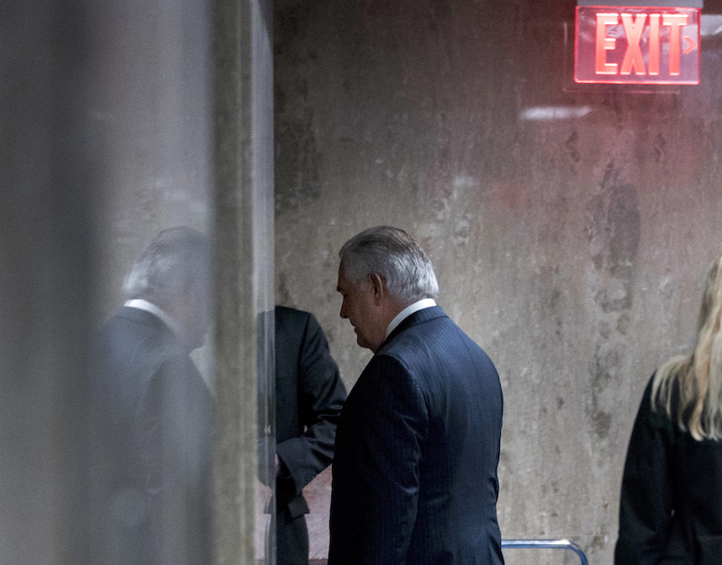 Secretary of State Rex Tillerson departs a State Department news conference after being fired by President Donald Trump on March 13, 2018.