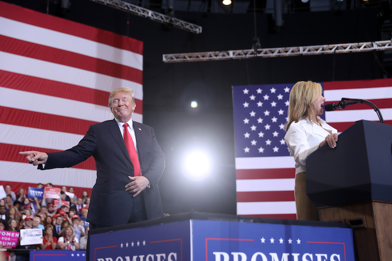 President Donald Trump gestures as Rep. Marsha Blackburn, R-Tenn., speaks at a rally at the Nashville Municipal Auditorium on May 29, 2018, in Nashville, Tenn. (AP)