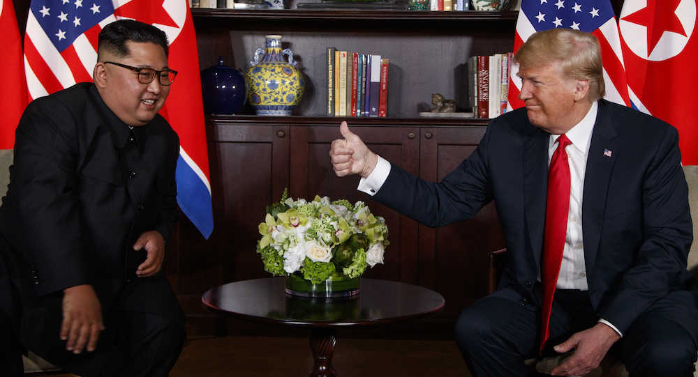 President Donald Trump meets with North Korean leader Kim Jong Un on Sentosa Island June 12, 2018, in Singapore. (AP)