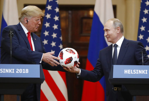 Russian President Vladimir Putin gives a soccer ball to U.S. President Donald Trump during a press conference after their meeting in Helsinki, Finland, on July 16, 2018. (AP/Alexander Zemlianichenko)