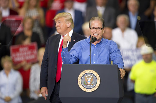 Mike Braun, Republican candidate for the U.S. Senate, thanks President Donald Trump for his endorsement during a campaign rally at the Ford Center on Aug. 30, 2018, in Evansville, Ind. (AP)