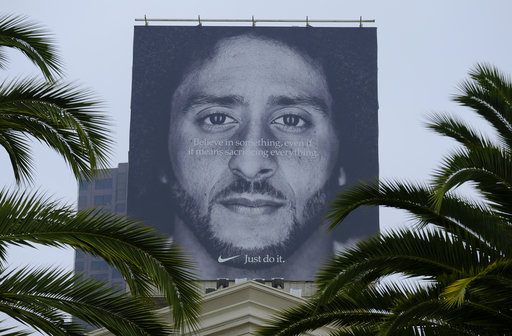 competitive price 4ba72 fd5ee A billboard stands on top of a Nike store showing former San Francisco  49ers quarterback Colin Kaepernick on Sept. 5, 2018, in San Francisco.