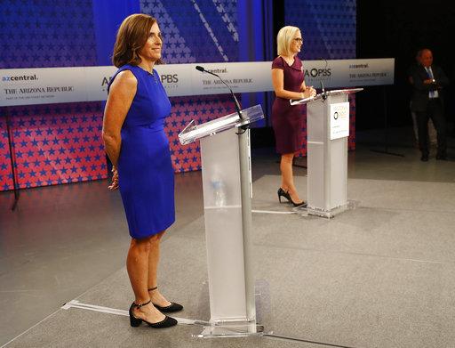 U.S. Senate candidates, U.S. Rep. Martha McSally, R-Ariz., left, and U.S. Rep. Kyrsten Sinema, D-Ariz., debated Oct. 15, 2018, in Phoenix. (AP Photo)