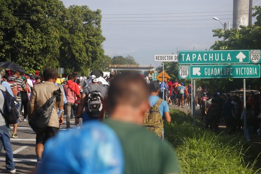 Central American migrants walk north toward Tapachula, after departing Ciudad Hidalgo, Mexico, Sunday, Oct. 21, 2018. (AP Photo/Moises Castillo)