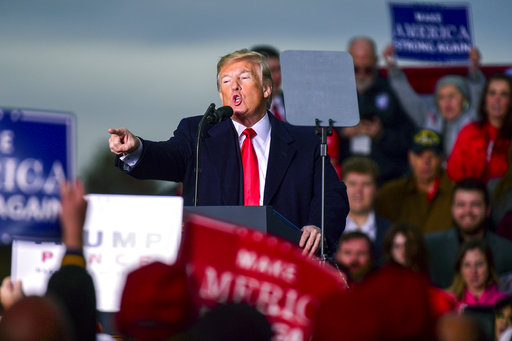 President Donald Trump speaks at a rally on Nov. 2, 2018, at the Tri-State Airport in Huntington, W.Va. (AP/Tyler Evert)