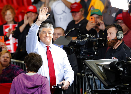 Sean Hannity waves at the audience before the start of a Trump campaign rally Nov. 5, 2018, in Cape Girardeau, Mo. (AP/Roberson)