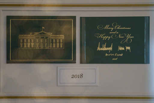 The First Family's holiday card is seen behind glass in Booksellers during the 2018 Christmas preview at the White House in Washington, Monday, Nov. 26, 2018. (AP Photo/Carolyn Kaster)