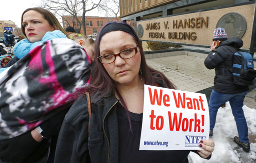 IRS worker Christine Helquist joins other federal workers rallying outside the Federal Building in Ogden, Utah, on Jan. 10, 2019, as a government shutdown continued. (AP)