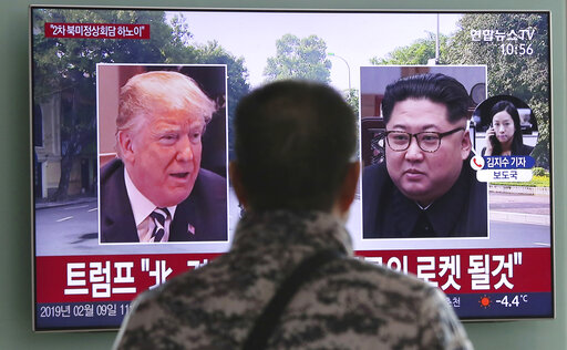 A man in Seoul, South Korea, watches a TV screen showing President Donald Trump and North Korean leader Kim Jong Un on Feb. 9, 2019. (AP)