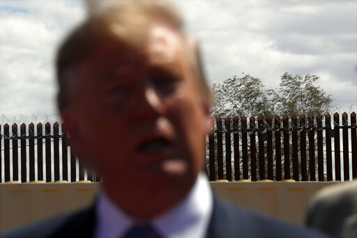 President Donald Trump speaks as he visits a new section of border barriers in Calexico, Calif.,  April 5, 2019. (AP/Jacquelyn Martin)