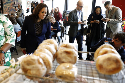Democratic presidential candidate Kamala Harris looks at pastries on display during a stop at a local cafe on April 11, 2019, in Des Moines, Iowa. (AP)