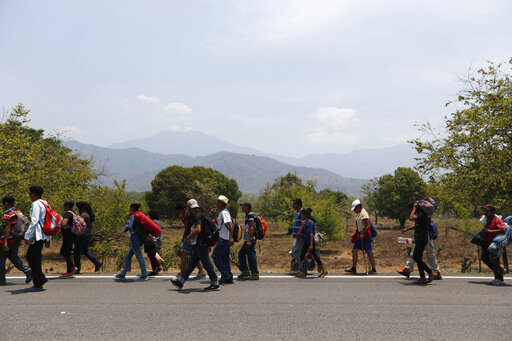 Central American migrants traveling in a caravan to the U.S. walk through Tonala, Chiapas state, Mexico, April 21, 2019. (AP/Moises Castillo)
