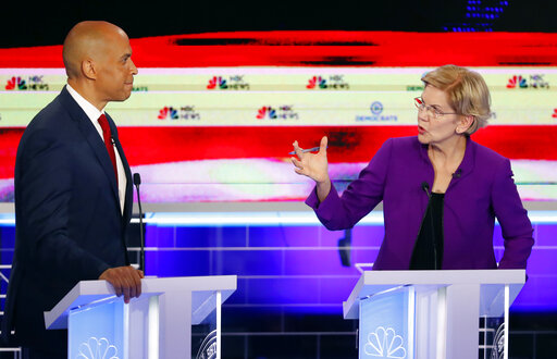 Democratic presidential candidates Elizabeth Warren and Cory Booker both criticized the state of the economy during a Democratic primary debate on June 26, 2019. (AP)