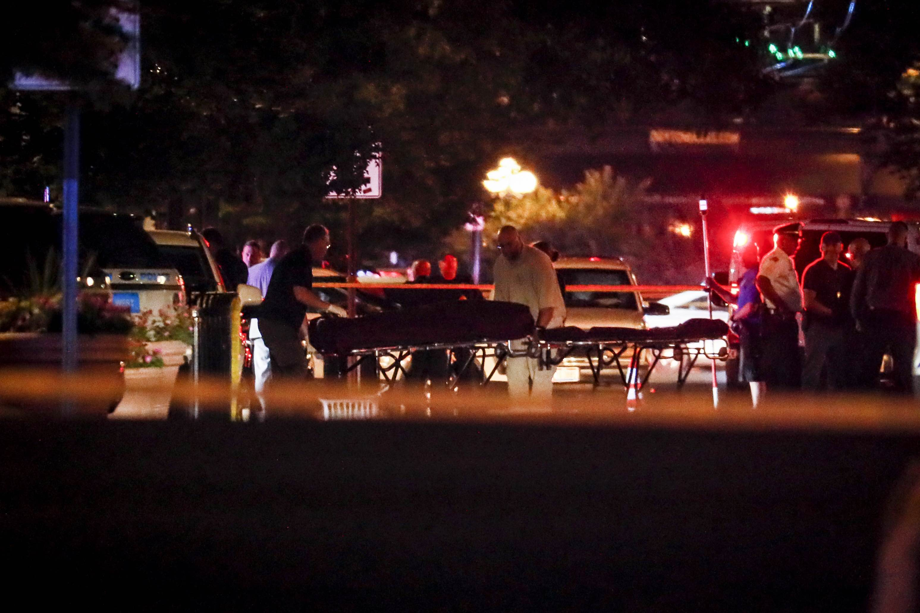Bodies are removed from at the scene of a mass shooting, Sunday, Aug. 4, 2019, in Dayton, Ohio. (AP Photo/John Minchillo)