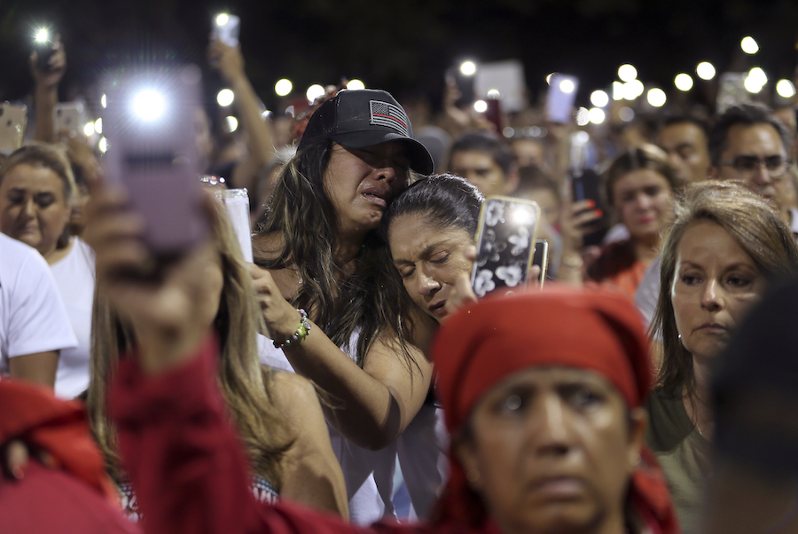 People grieve during the Hope Border Institute prayer vigil Sunday, Aug. 4, 2019 in El Paso, Texas, a day after a mass shooting at a Walmart store. (AP)
