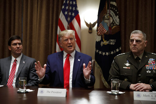 President Donald Trump, joined by Defense Secretary Mark Esper and Chairman of the Joint Chiefs of Staff Gen. Mark Milley, speaks during a briefing with senior military leaders at the White House on Oct. 7, 2019. (AP/Kaster)