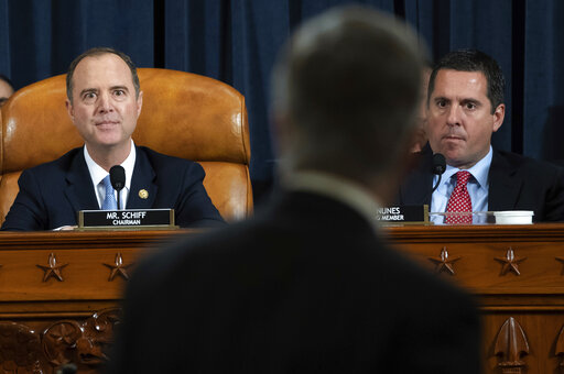 House Intelligence Committee Chairman Rep. Adam Schiff, D-Calif., and ranking member Rep. Devin Nunes, R-Calif., watch as Ambassador William Taylor leaves after testifying at a Nov. 13, 2019, hearing in Washington. (AP/Loeb)