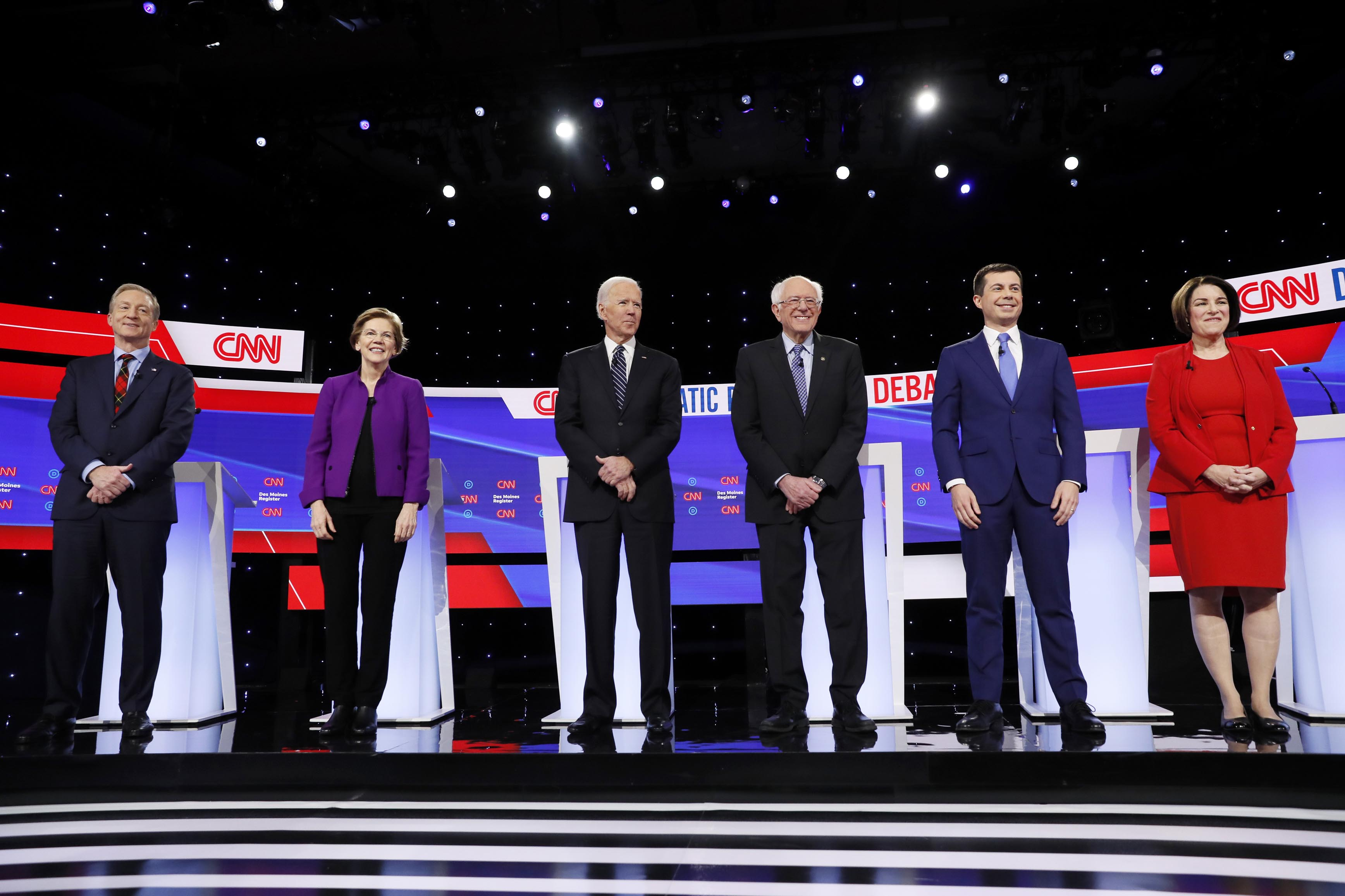 Democratic presidential candidates stand on stage Jan. 14, 2020, before a Democratic presidential primary debate hosted by CNN and the Des Moines Register in Des Moines, Iowa. (AP)