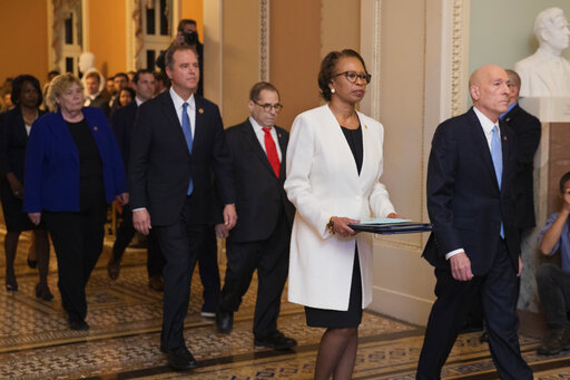 House Sergeant at Arms Paul Irving and Clerk of the House Cheryl Johnson carry the articles of impeachment against President Donald Trump to Secretary of the Senate Julie Adams on Jan. 15, 2020. (AP)