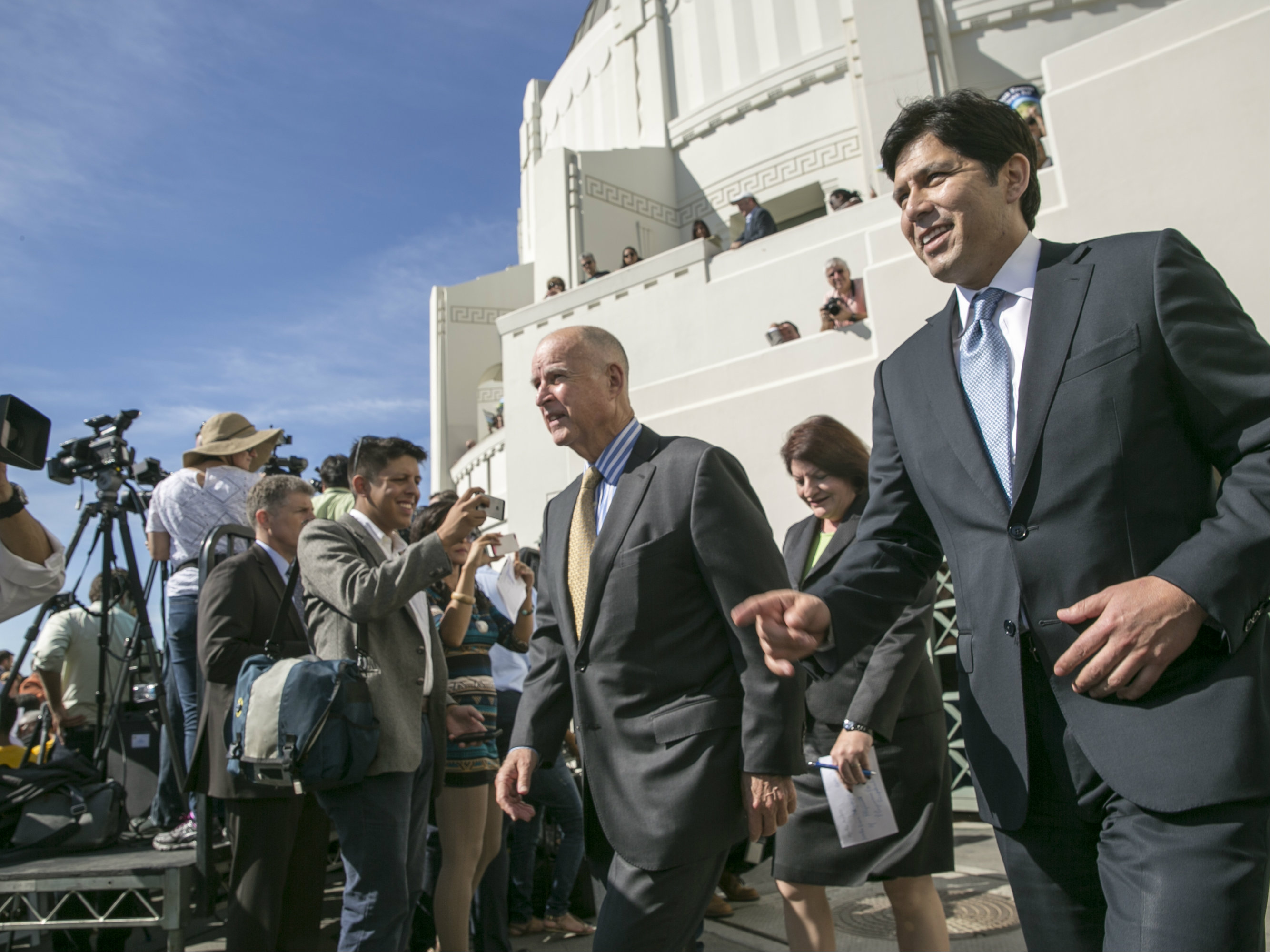 California Gov. Jerry Brown, center, arrives with Senate President pro Tempore Kevin De Leon, D-Los Angeles, right, and Assembly speaker Toni Atkins, second from right, to sign landmark legislation SB 350 to combat climate change. Damian Dovarganes / AP