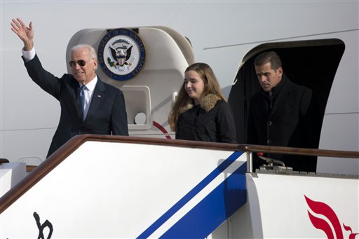 Then-Vice President Joe Biden arrives on Air Force Two in Beijing, China, with his son Hunter Biden and his granddaughter Finnegan Biden on Dec. 4, 2013. (AP)