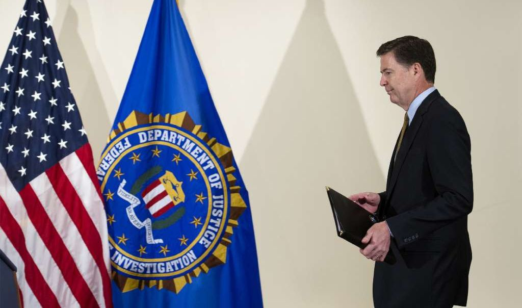 FBI Director James Comey walks to the podium to make a statement at FBI Headquarters in Washington, Tuesday, July 5, 2016.  (AP)