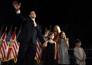 Senator-elect Marco Rubio and his family wave to supporters Tuesday night in Miami.
