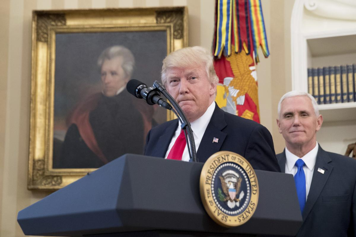 In this March 31, 2017, file photo, a portrait of former President Andrew Jackson hangs on the wall behind President Donald Trump, accompanied by Vice President Mike Pence, in the Oval Office at the White House in Washington. (AP)