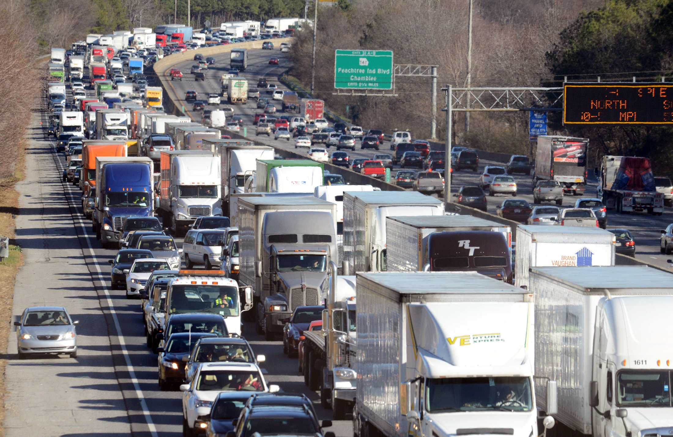 Traffic snarls on I-285 westbound due to a midday accident. Photo by Kent D. Johnson / AJC