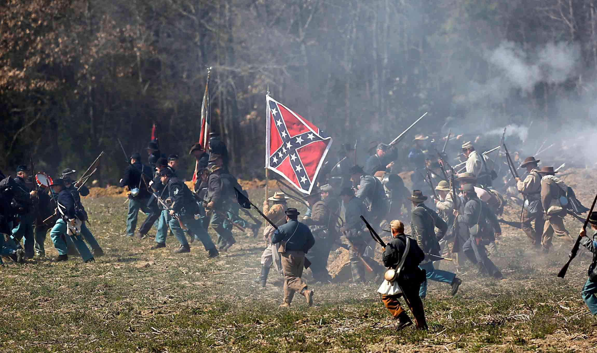 Civil War re-enactors battle during the 150th anniversary of the Battle of Bentonville on March, 21, 2015 in Four Oaks, N.C. News & Observer photo.