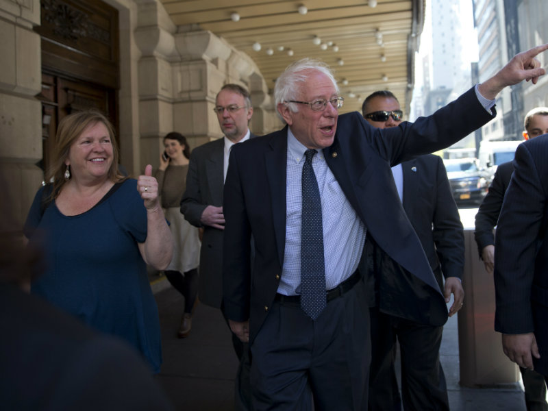 Democratic presidential candidate Sen. Bernie Sanders, I-Vt., and his wife Jane, gesture at supporters as they take a walk in New York's Times Square, Tuesday, April 19, 2016. (AP Photo/Mary Altaffer)