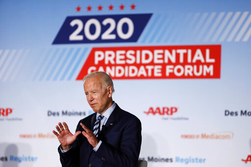 Democratic presidential candidate Joe Biden describes his healthcare plan during a presidential candidates forum sponsored by AARP and The Des Moines Register in Iowa. (AP Photo/Charlie Neibergall)