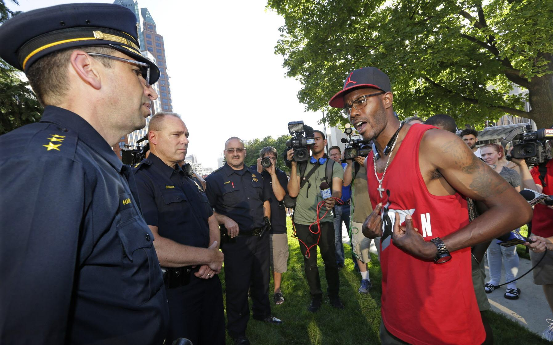Nate Hamilton, the brother of Dontre Hamilton, who was killed by a Milwaukee police officer, talks with Milwaukee police during a Black Lives Matter rally in July 2016. (Milwaukee Journal Sentinel/Mike De Sisti)