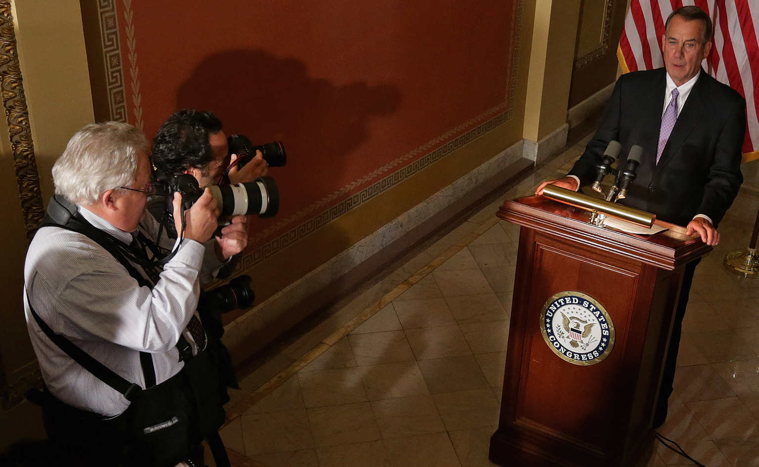 Speaker of the House John Boehner talks with reporters after President Barack Obama announced he would stop deportations of some undocumented immigrants. (Getty Images)