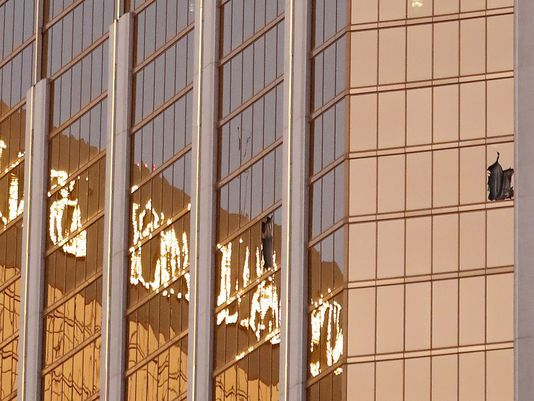 Broken windows are seen on a high floor of the Mandalay Bay hotel in Las Vegas following a mass shooting on Oct. 1, 2017. (Paul Buck/EPA-EFE)