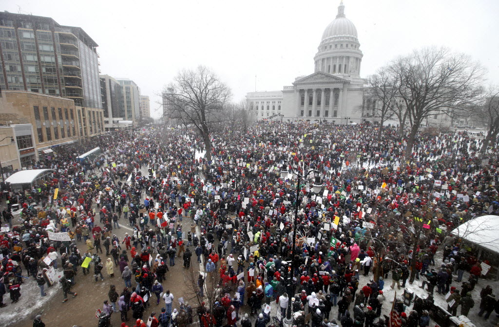 Thousands of people gather outside the Capitol in Madison to protest Wisconsin Gov. Scott Walker's budget-repair bill