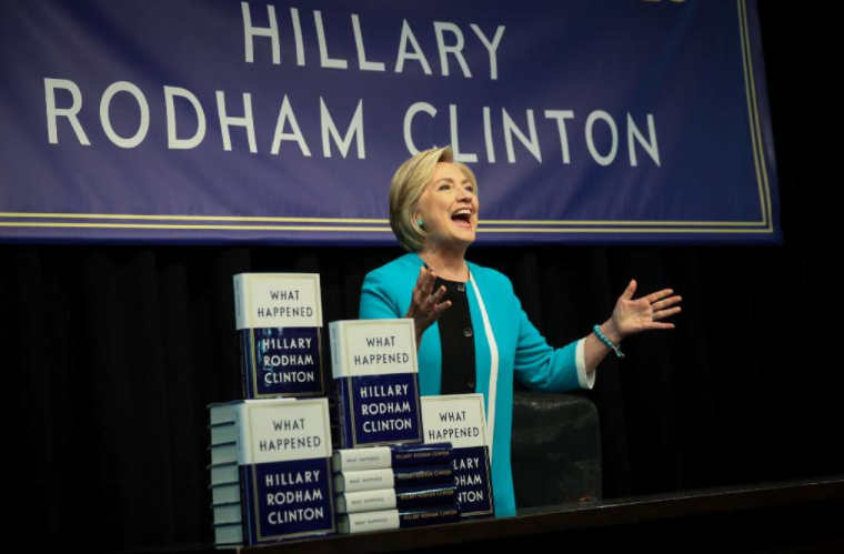 "Former Democratic nominee Hillary Clinton acknowledges the audience as she arrives to sign copies of her new book ""What Happened"" during an event in New York City. (Getty Images)"