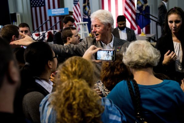 Former President Bill Clinton reaches out to shake hands after speaking to nearly 500 people on Oct. 3, 2016, at Northbank Center in Flint, Mich. (Jake May/Flint Journal via AP)