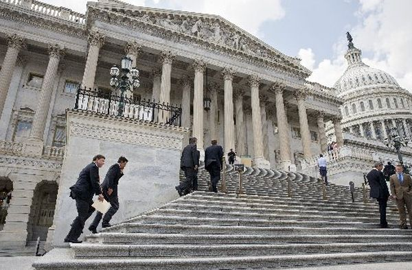 Members Congress climb the steps of the U.S. House of Representatives for votes on July 31, 2014.
